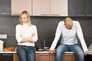 The image of quarrel of a married couple on kitchen